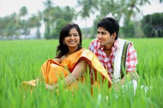 Couple sitting in a paddy field