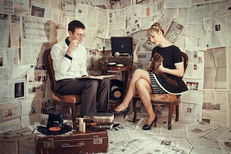 Couple sitting listening to a turntable