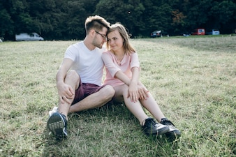 Couple sitting on the lawn lovingly