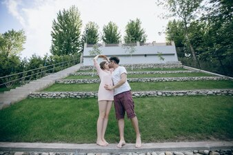 Couple standing holding hands in a garden
