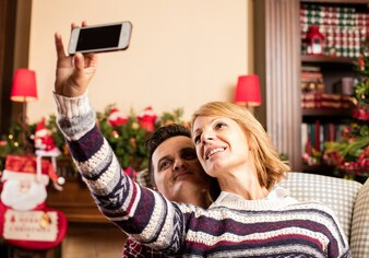 Couple taking a selfie on christmas