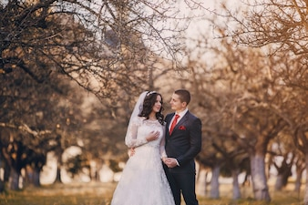 Couple under a leafless tree