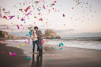 Couple using two confetti cannons