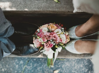 Couple with a bouquet of flowers at their feet