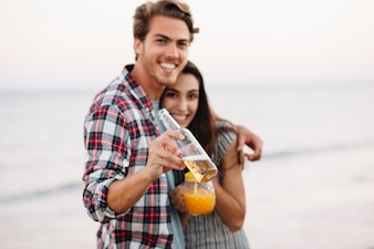 Couple with drink at the beach