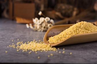 Couscous in a wooden spoon