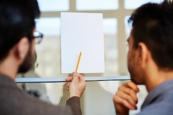 Coworker showing noticeboard job idea
