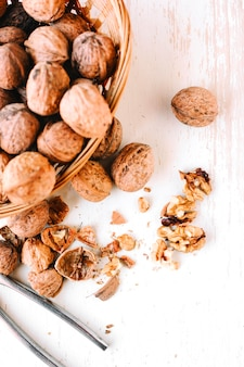 Cracked walnuts on wooden table