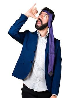 Crazy businessman making drunk gesture
