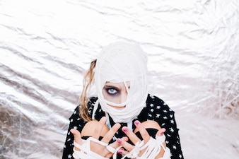 Crazy girl with bandaged head and hands