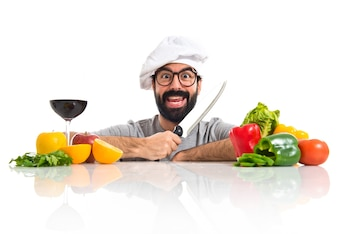 Crazy hipster chef with several vegetables and fruits