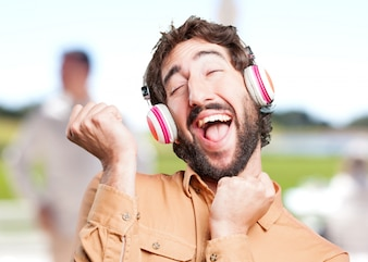 Crazy man with headphones.funny expression