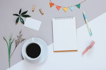 Creative flat lay photo of cute workspace desk with notebook, coffee, name card and decorated cute craft with copy space background, minimal style