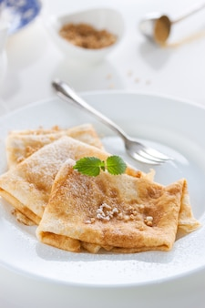 Crepes with icing sugar