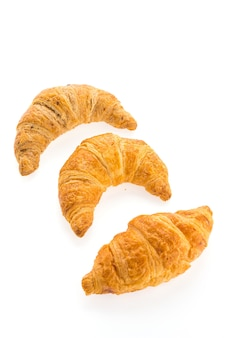 Croissants in a row on a white background