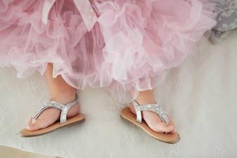 Crop baby feet in stylish clothing