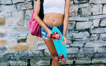 Crop girl with cruiser board