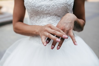 Crop of bride showing ring on hand