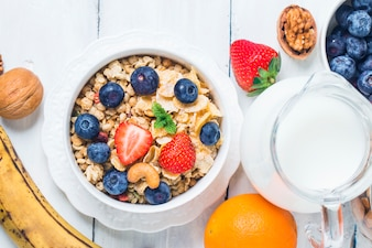 Crunchy flakes with blueberries and various yogurts for healthy breakfast, close-up