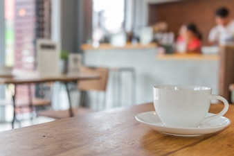 Cup and saucer on wooden table