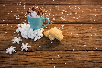 Cup of coffee with cinnamon and fake snow