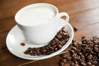 Cup of coffee with coffee beans and spoon