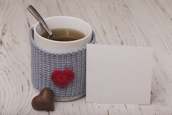 Cup of tea with a heart with a white paper