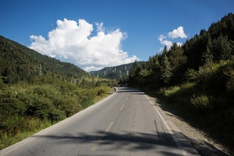 Curve on a road with mountains at the sides