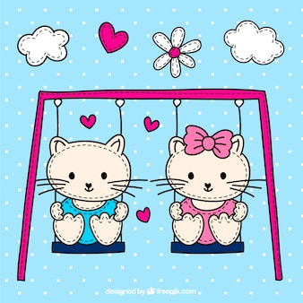 Cute cats on the swing