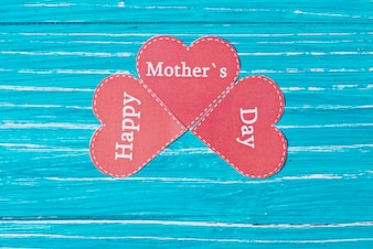 Cute composition with paper hearts for mother's day