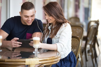 Cute couple having a coffee together
