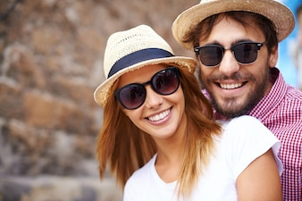 Cute couple with hats and sunglasses close-up