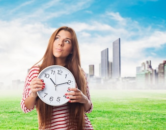 Cute girl with a clock