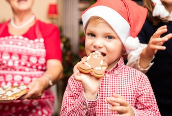 Cute kid biting a christmas cookie