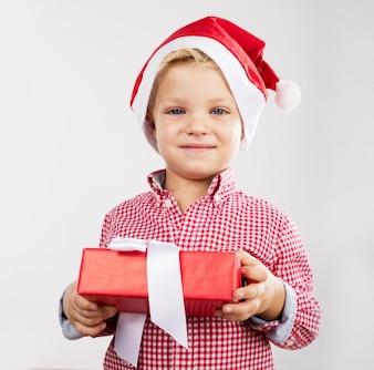 Cute little boy holding a present