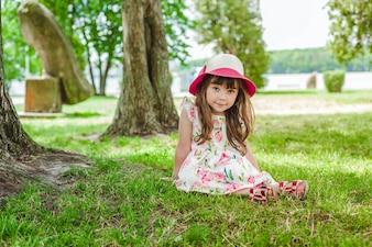 Cute little girl posing in the park