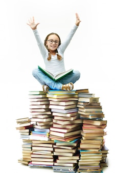 Cute little girl with books