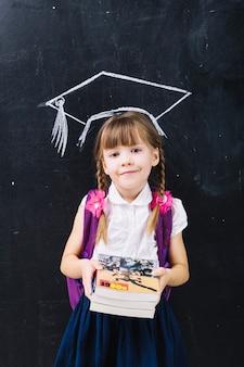 Cute schoolgirl in master hat
