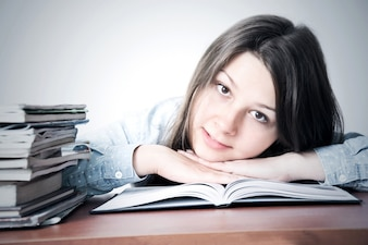Cute smart young girl studying.
