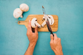 Cutting mushrooms with knife
