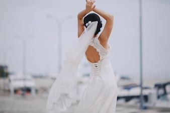 Dancing bride at the port