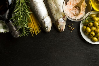 Dark background with fish and other ingredients