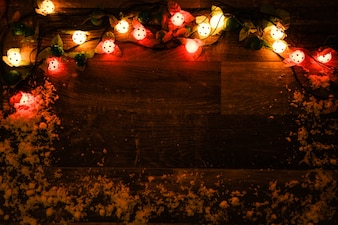 Dark wood wall with lights and snow