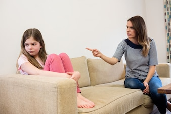 Daughter ignoring her mother after an argument in living room