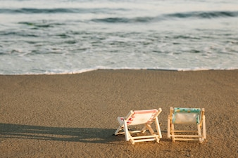 Deck chairs close to the shoreline
