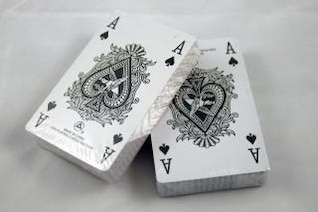 deck of card stacked with ace of spade on top