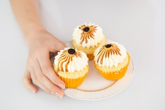 Decorated cupcakes on small plate