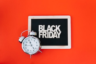 Decoration for black friday with clock on slate