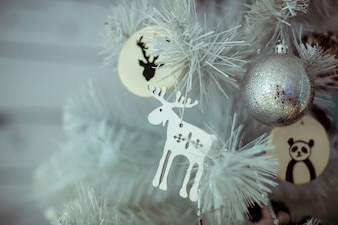 Decoration of a christmas tree on a white tree