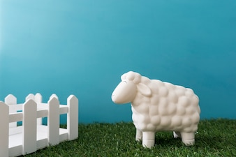 Decorative background with wooden fence and sheep